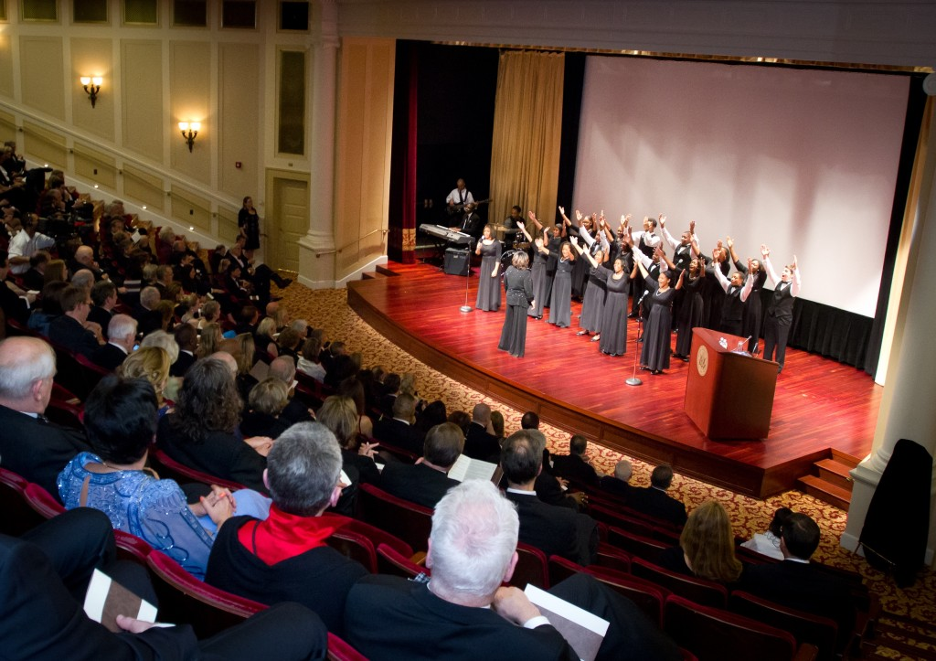 A choir performing in the William G. McGowan Theater