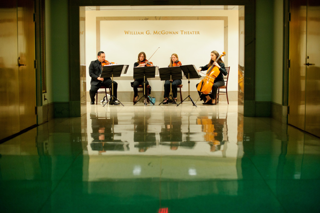 A string quartet invites guests into the William G. McGowan Theater