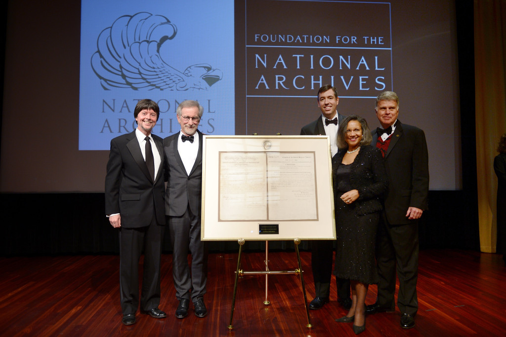 "(L-R) Foundation for the National Archives Board Vice President and Gala Chair Ken Burns, filmmaker and honoree Steven Spielberg, Executive Director of the Foundation for the National Archives Patrick Madden, Foundation for the National Archives Chair and President A'Lelia Bundles, and Archivist of the United States The Honorable David S. Ferriero pose onstage with facsimile versions of the ""two 13th Amendments"" at the Foundation for the National Archives 2013 Records of Achievement award ceremony and gala in honor of Steven Spielberg on November 19, 2013 in Washington, D.C. (Photo by Michael Loccisano/Getty Images for Foundation for the National Archives)."