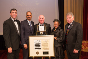 National Archives Foundation Executive Director Patrick M. Madden, former Attorney General Eric Holder, Records of Achievement Award honoree Taylor Branch, Foundation Chair A'Lelia Bundles, and Archivist of the United States David S. Ferriero with the 2015 Records of Achievement Award, featuring facsimilies of a redacted document from Mr. Branch's Freedom of Information Act (FOIA) lawsuit against the FBI, as well as a facsimile of that same document, which has recently been declassified. Photo by Pepe Gomez for the National Archives Foundation.
