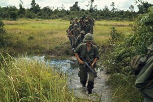"""Vietnam....Members of Company B, 1st Battalion, 27th Infantry Regiment (Wolfhounds), 25th Infantry Division, cross a stream approximately 15 kilometers southeast of Nui Ba Den during search and clear operations near Fire Support Base Kien"""