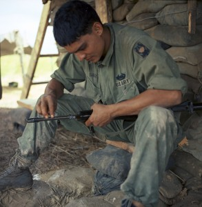 """Operation Shelby - Pfc Manuel Garcia (El Centro, Calif.) rifleman...cleans his M-16 rifle..."" 8/25-26/1967"